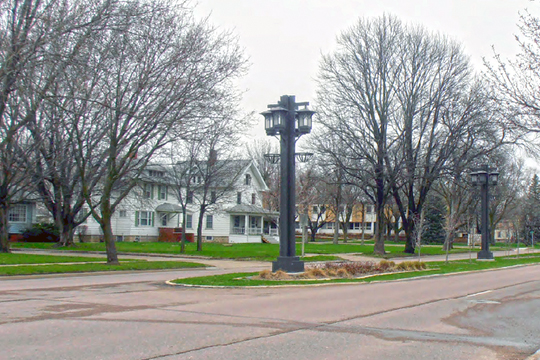 View of streetscape and houses on the west side of the 1300 block of North Grand, Spencer, IA