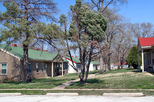 View down central green between Lane OO and Lane P from Lake Shore Drive, Sunflower Village Historic District, De Soto, KS, National Register