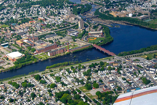 Aerial view of Lowell UMass (upper left) and surrounding homes, Pawtucketville neighborhood, Lowell, MA.