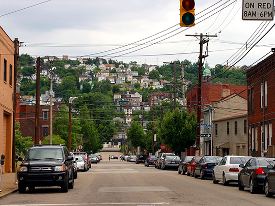 East Carson Street, Pittsburgh, PA, with Southside Slopes in the background.